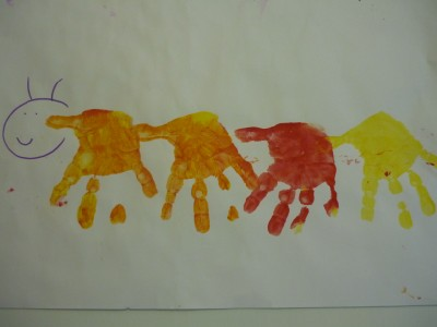 Handprint caterpillars- painting with babies