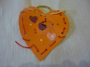 Heart shaped weaving collage. Valentine easy art idea