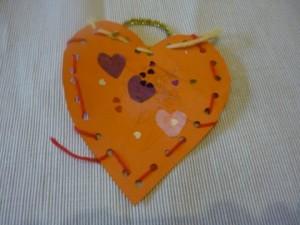 Heart shaped weaving collage. Valentine easy art idea